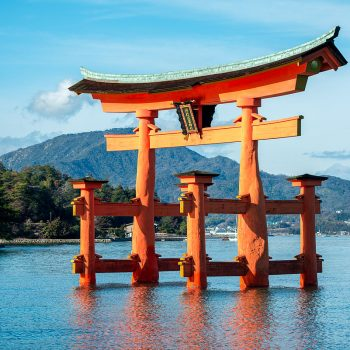 A very large vermillion torii (shrine gate) rising out of the sea