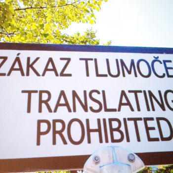 "Sign saying ""Translating prohibited"" in Polish, with a translation into English directly beneath"