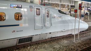 Side view of the front of a N700-series shinkansen train