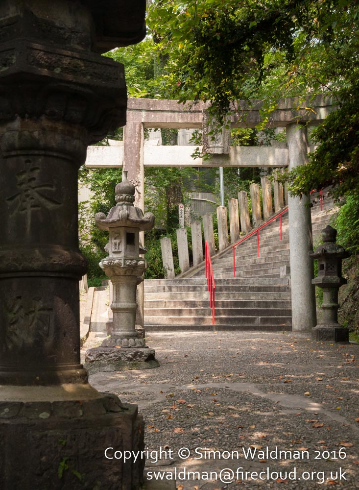 More steps, another torii, and some stone lanterns