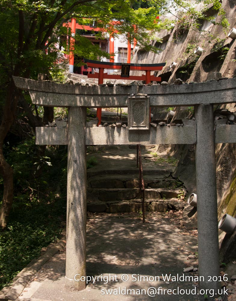 Small concrete torii in woodland