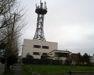 Communications tower rising from a municipal telecoms building in Japan