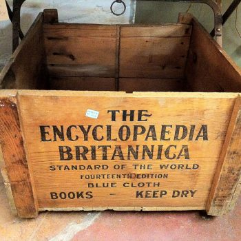 "Empty wooden shipping crate labelled ""The Encyclopedia Britannica : Standard of the world, Fourteenth Edition. Books - keep dry"""