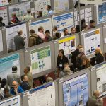 View of rows of academic posters at a poster session.