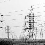 Black and white picture of lots of transmission towers