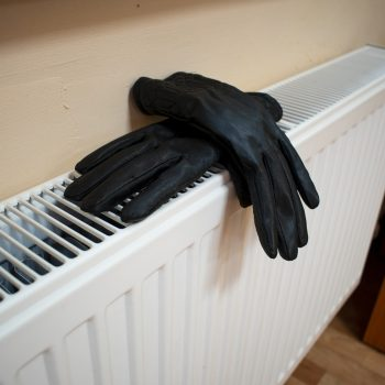 Pair of gloves drying on a radiator